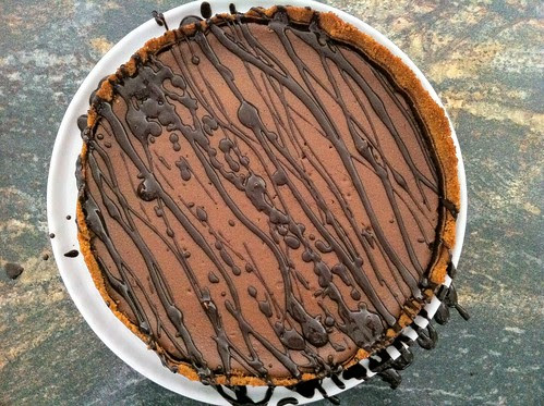 Chocolate Ganache Drizzled Over Cheesecake