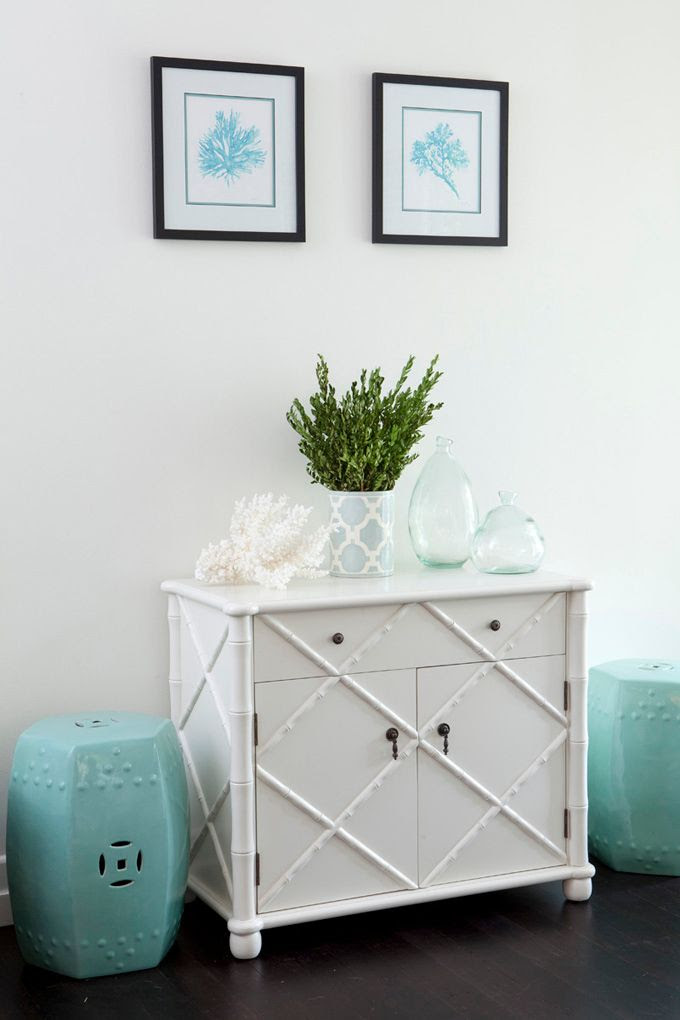 LOVE this...aqua ceramic garden stools, faux bamboo cabinet, natural elements.  via House of Turquoise