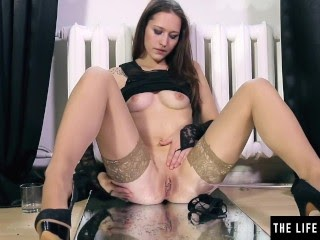 Pissing and panty-stuffing beauty squats over a mirror to orgasm