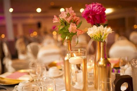 gold painted bottles make perfect vases for a centerpiece
