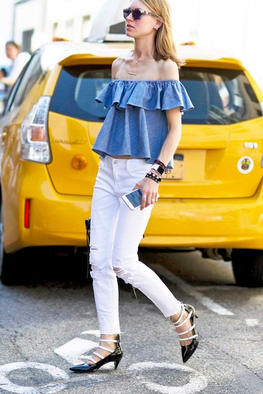 Le Fashion Blog Nyfw Street Style Ruffled Denim Off The Shoulder Top Ripped White Jeans Stack Of Bracelets Black And White Lace Up Kitten Heels Via Style Caster
