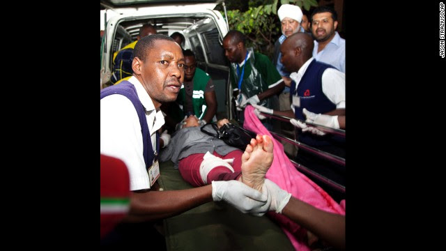 An injured person is helped on arrival at the Aga Khan Hospital in Nairobi after the attack at the upscale mall.