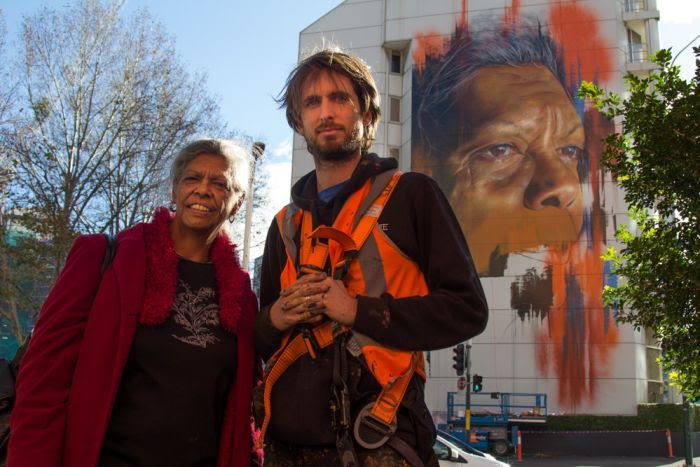 Jenny Munro with artist Matt Adnate in front his mural in Sydney CBD