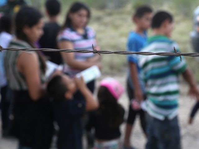 ROMA, TX - AUGUST 17:  Immigrants from Central America wait to be taken into custody by U.S. Border Patrol agents on August 17, 2016 in Roma, Texas. Thousands of Central American families continue to cross the Rio Grande at the Texas-Mexico border, seeking asylum in the United States. Border security has become a major issue in the U.S. Presidential campaign.  (Photo by John Moore/Getty Images)