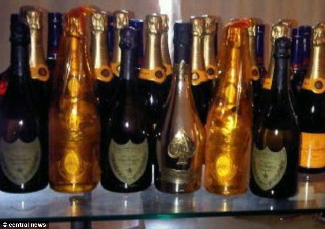 Onyeachonam was jailed eight years last year, after he was exposed as the chief player in the scam. Pictured is champagne found at his home