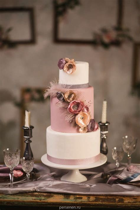 Dusty pink, mauve, pale rose wedding cake with feathers