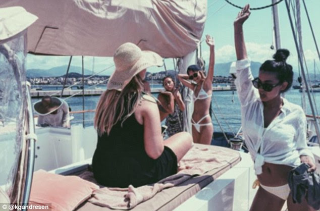 Party boat: Katharina always seems surrounded by friends and family when on her exotic holidays - all equally glamorously dressed
