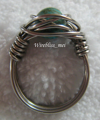 Twice around the world (TAW) wire wrap ring