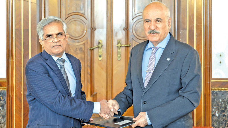 Finance and Mass Media Ministry Secretary Dr. R.H.S. Samaratunga and OFID Director General Suleiman J. Al-Herbish exchanging the agreement on July 3 at the OFID Headquarters in Vienna, Austria.