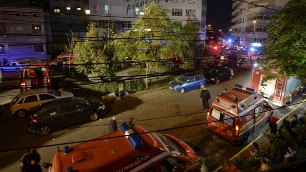 Emergency services work outside a nightclub in Bucharest, Romania
