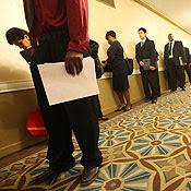 Job seekers line up to attend a job fair