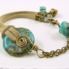 Turquoise suede and antiqued brass chain and wire bracelet.  Love how the suede cord is looped through the doughnut.  Wonder if I can loop start a bunch with thinner cord, and set them loose at class to bead the cord from there, back to a clasp for a finish.