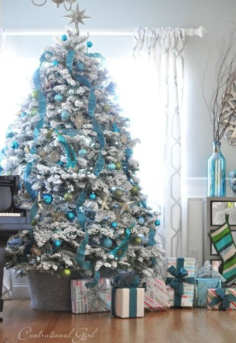 A white frosted tree has tons of combination possibilities. Try mixing in pops of blue for an icy effect.  See more at Centsational Girl »