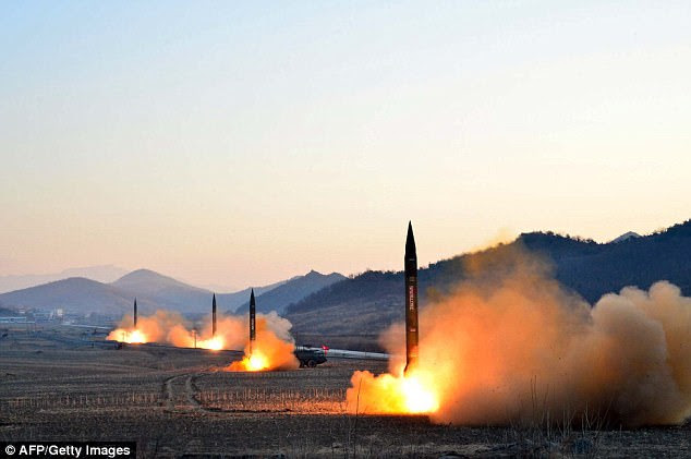 This undated picture released by North Korea's Korean Central News Agencyon March 7, 2017 shows the launch of four ballistic missiles by the Korean People's Arm