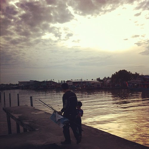 Father and child fishing in the morning