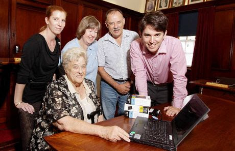 HISTORY: George Seymour (right) shows Kay Gassan (seated), Karla Chisholm, Jan Downman and Ian Scougall more than a century's worth of files from hard drives presented to the local historians.