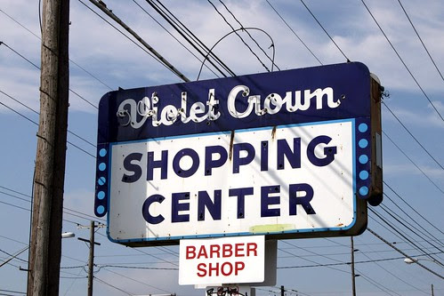 violet crown shopping center neon sign