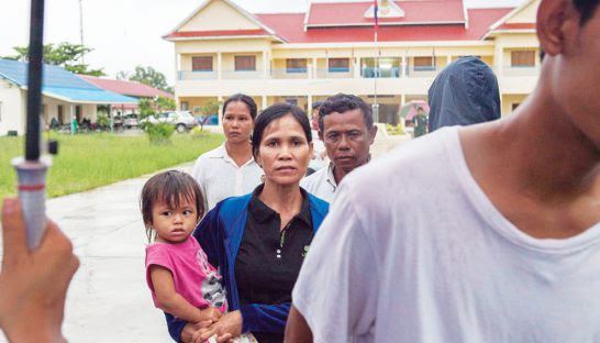 Witnesses and family members of accused Mother Nature activists leave the Koh Kong Provincial Court on Monday.