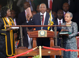 Kenyan President Uhuru Kenyatta taking the oath of office in Nairobi. Kenyatta became the fourth head of state over the last fifty years. He was sworn in on April 9, 2013. by Pan-African News Wire File Photos