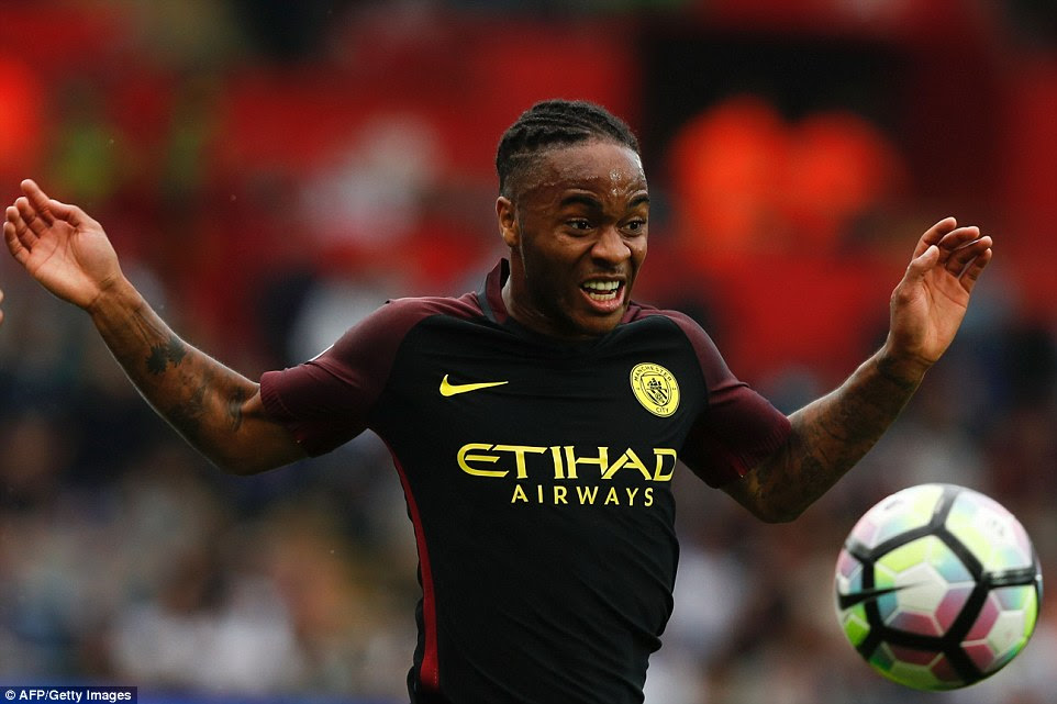 Raheem Sterling spreads his arms wide as he looks to control the ball in the middle of midfield in south Wales