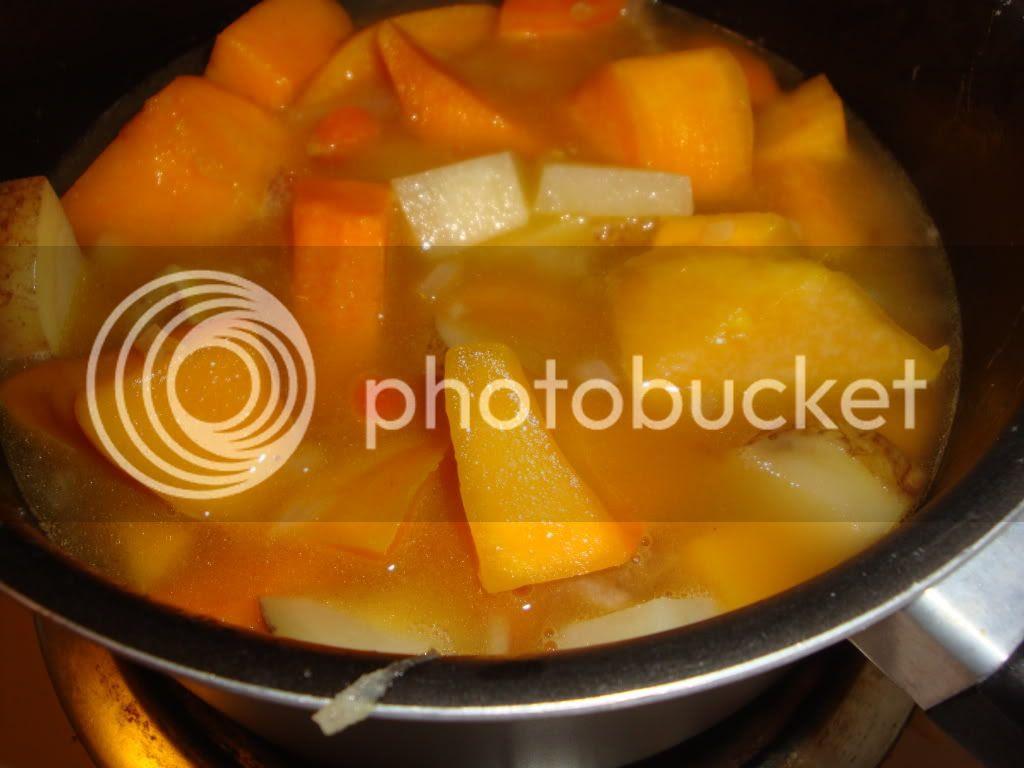 Veggies and broth in pot