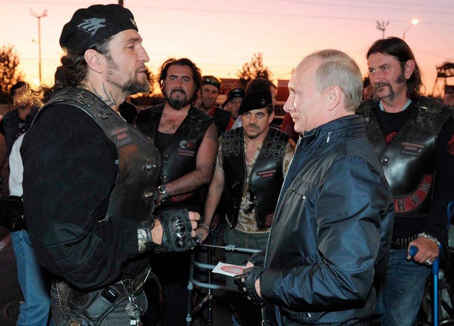 Russian President Vladimir Putin head of the c-bike club Night Wolves Zaldostanovym Alexander, also known as surgeon at the bike festival in Novorossiysk August 29, 2011.