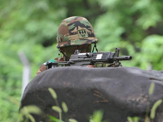 Soldado foi condenado por limpar fuzil em máquina de lavar na Coreia do Sul (Foto: AFP)