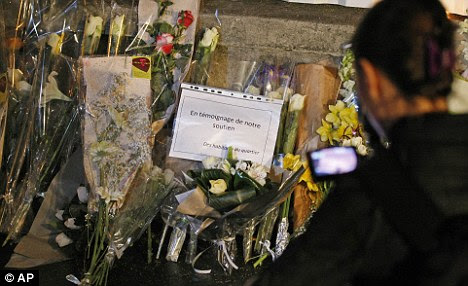 Grief: Flowers and messages were left outside the school where a father and two sons, and another girl, were gunned down
