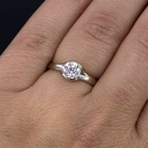 Lab Created Round White Sapphire Fold Solitaire Engagement