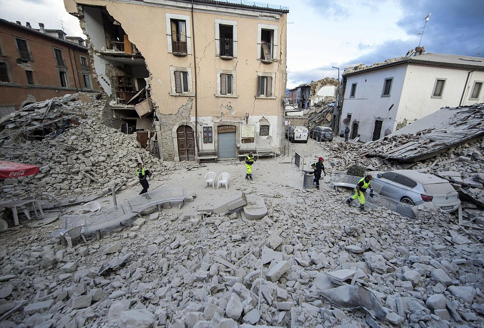 The same town square in Amatrice is seen here from a different angle. Above the building is intact but below half of it has crumbled to the ground