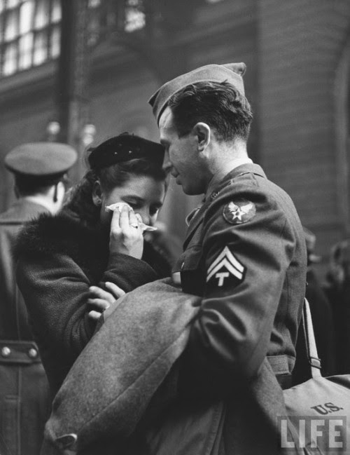 allaboutthepast:  A soldier comforts his girlfriend while saying goodbye at Pennsylvania Station, photographed by Alfred Eisenstaedt (1944).