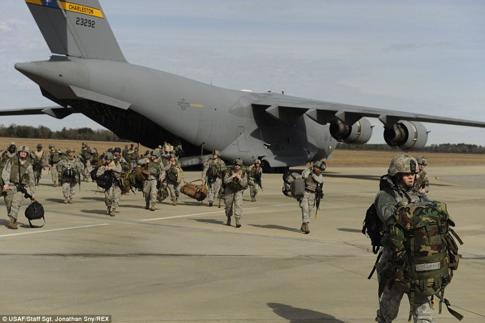 Airmen: Combat camera Airmen exit a C-17 Globemaster III while participating in an exercise designed to test their ability to survive and operate in an austere environment at Air Force North's Auxiliary Airfield in South Carolina. The 1st Combat Camera Squadron conducts this exercise every year as a culminating training event to reinforce skills taught throughout the year