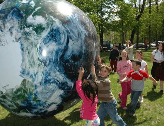 Image result for kids pushing a giant Earth ball