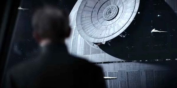 Grand Moff Tarkin(?) watches as the Death Star's superlaser weapon is installed in ROGUE ONE: A STAR WARS STORY.