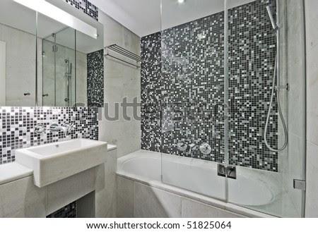 Modern Luxury Bathroom With Large Bath Tub And Mosaic Tiles Stock ...