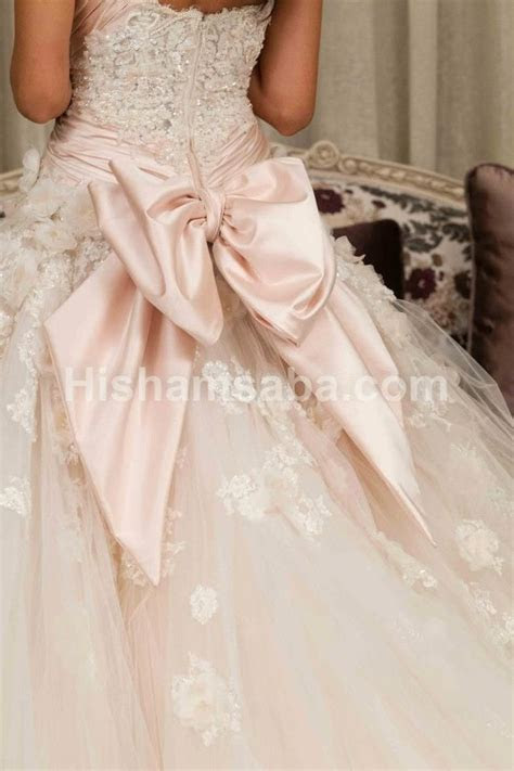 Bow wedding gown baxk . A pale pale pink wedding dress