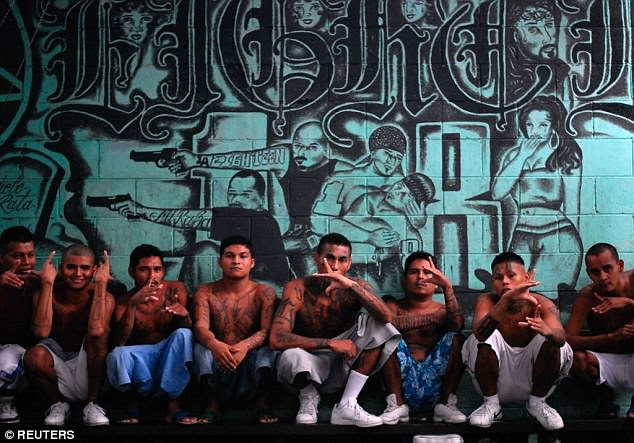 The Barrio 18 gang was founded in Los Angeles and was initially ethnically Mexican, but has grown enormously in Honduras, El Salvador and Guatamala. Pictured: Members in El Salvador