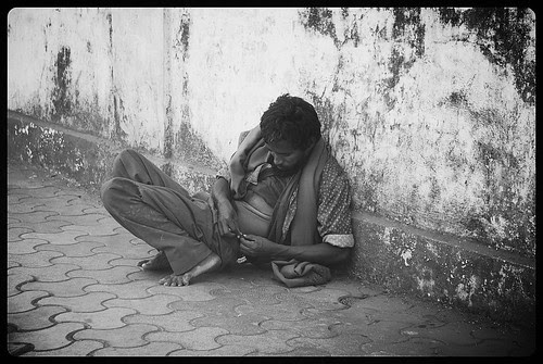 The Madman Removing Ticks From His Clothes by firoze shakir photographerno1