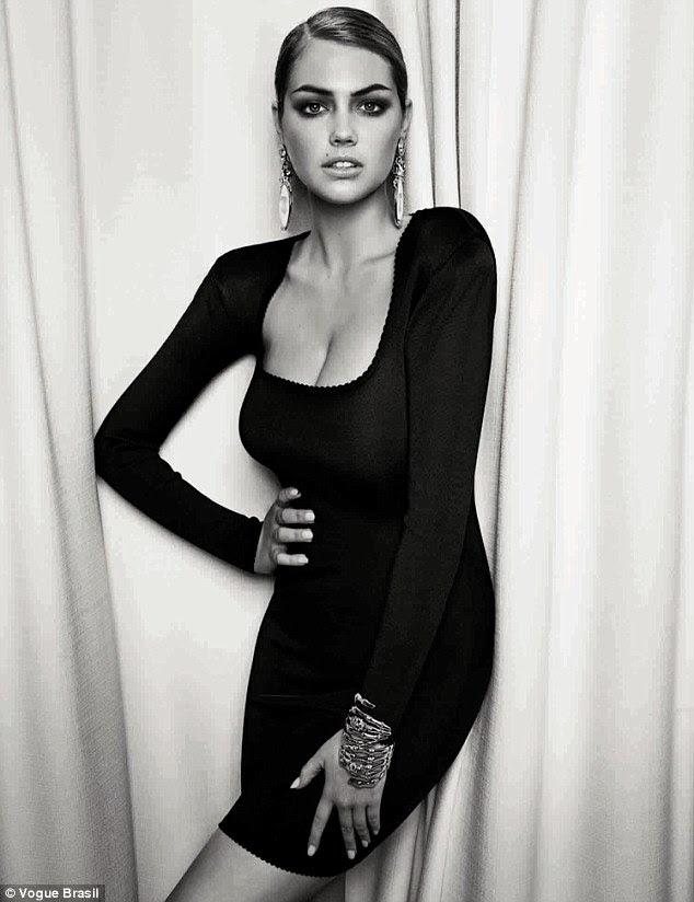Simmer for the camera: Blonde bombshell Kate Upton captured dark glamour in her shoot for Vogue Brazil