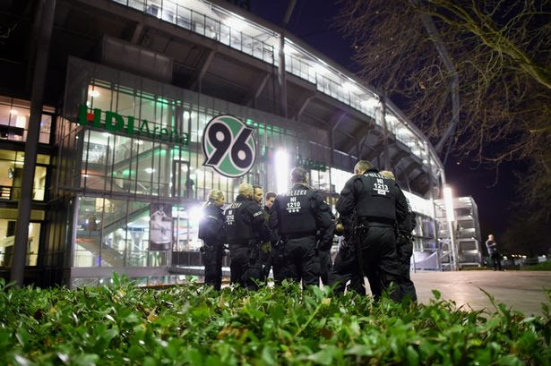 Police forces secure an entrance of the the HDI-Arena