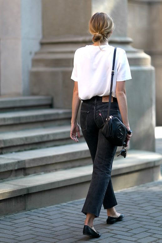 Le Fashion Blog Fall Blogger Style Blonde Low Bun Red Lips Slouchy White Tee Leather Gucci Crossbody Bag With Tassel Raw Hem Cropped Levis Black Jeans Flats Via Fashion Mugging