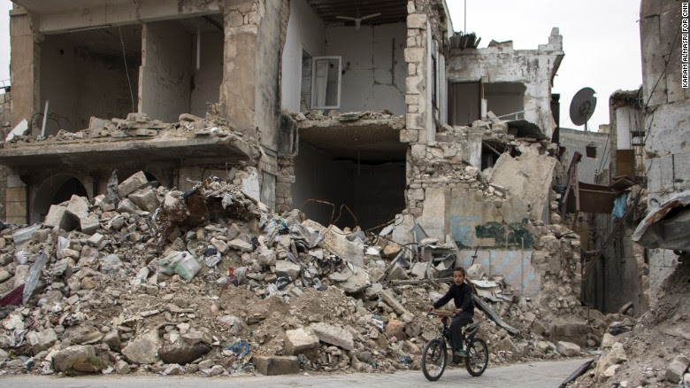 A boy rides a bike during the ceasefire.