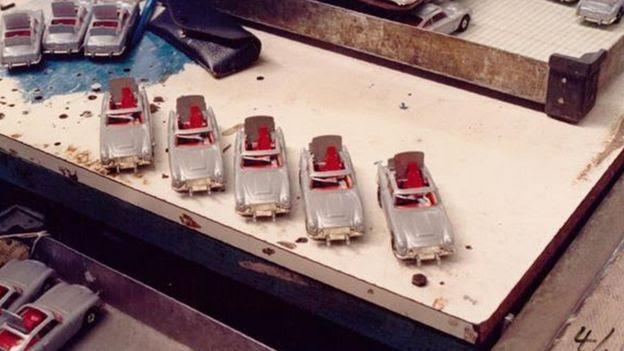 Five Aston Martin DB5's on the workbench
