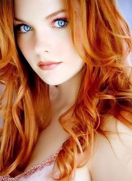 This beautiful redhead is looking really hot in her bikini