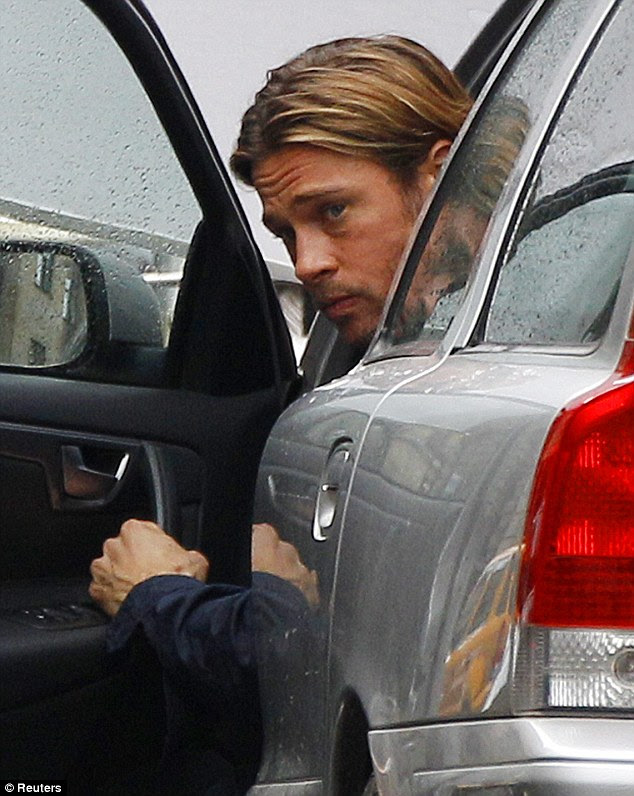 Buckle up: Brad gives one last look out of the car door before shooting the scene
