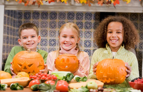 Three children with pumpkins