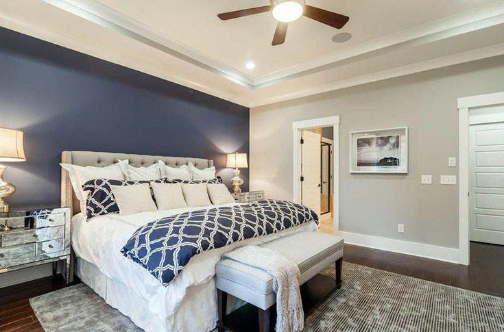 Master Bedroom With Light Gray Walls And Dark Blue Accent