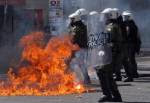 Protesters  clash with riot policemen during a  a general strike protest in AthenS