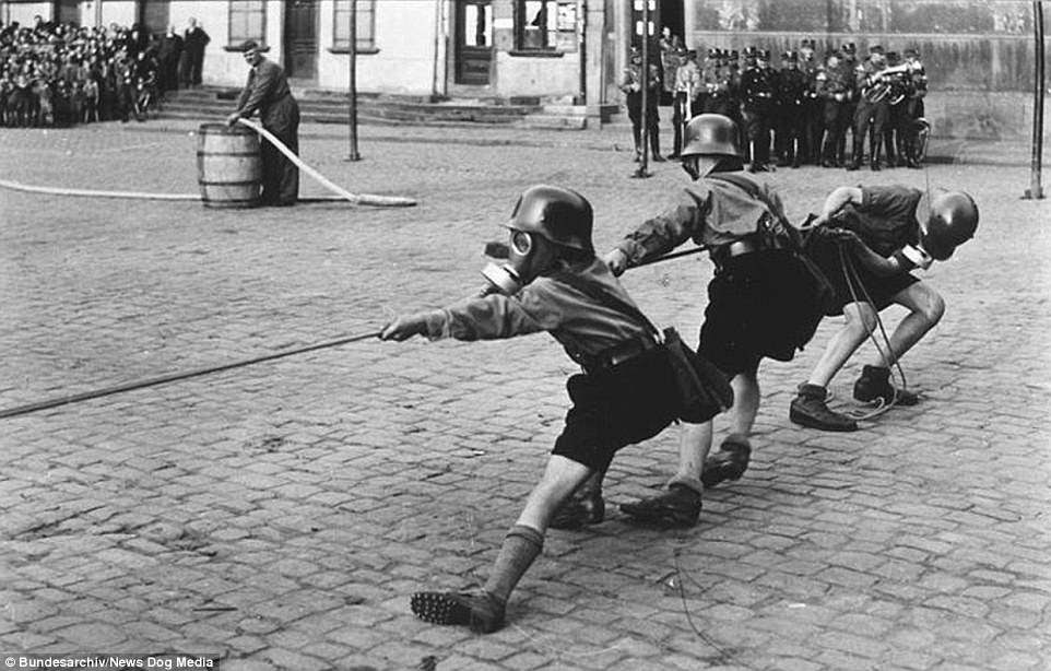 These Hitler Youth boys wearing gas masks in                       1933 are being indoctrinated into the Nazi Party.                       The Hitler Youth's main focus was dramatically                       expanding the size of the army, teaching                       youngsters how to shoot, march, and read a map -                       all skills which are needed by soldiers - however,                       by late 1944 and early 1945 Hitler Youth was                       involved in the defence of Berlin