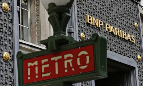 A Paris Metro sign is seen outside a central Paris agency of French bank BNP Paribas